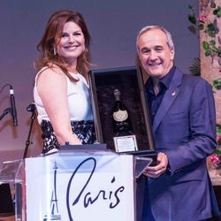Elizabeth Blau accepts the Dom Perignon Award of Excellence from Larry Ruvo at UNLVino's Grand Tasting.