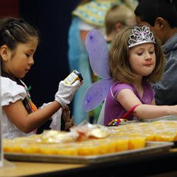 Students Andrea, left, and Hailey choose their food during the Breakfast in the Classroom program at Backman Elementary School in Salt Lake City on Friday, Oct. 28, 2016.