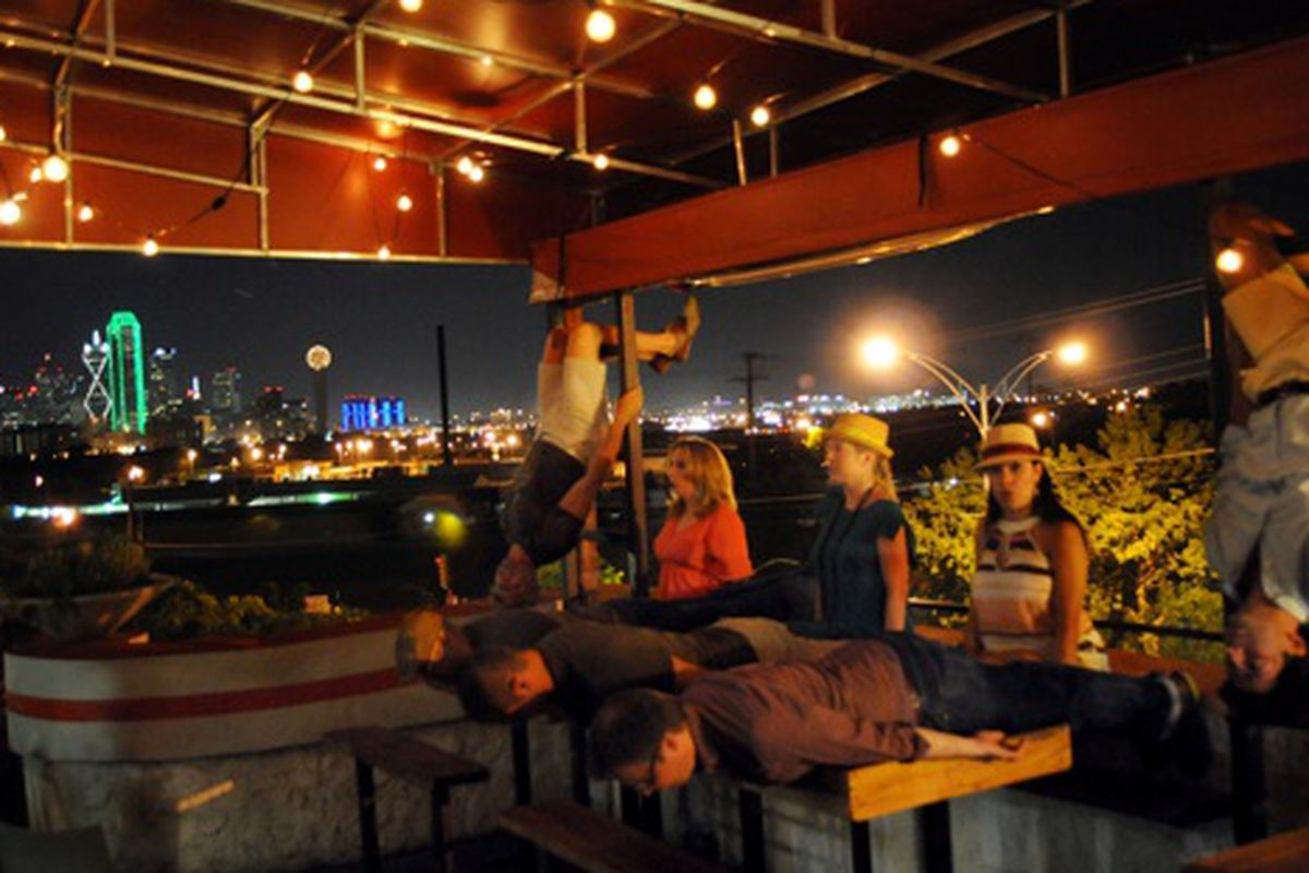 Planking, owling and batting with a view of the Dallas skyline.