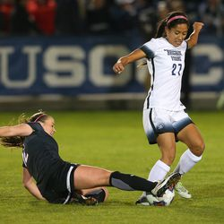 UNLV Georgia Kingman (12) slide tackles BYU Elena Medeiros (27) as BYU and UNLV play in the first round of the NCAA tournament in Provo on Friday, Nov. 11, 2016.
