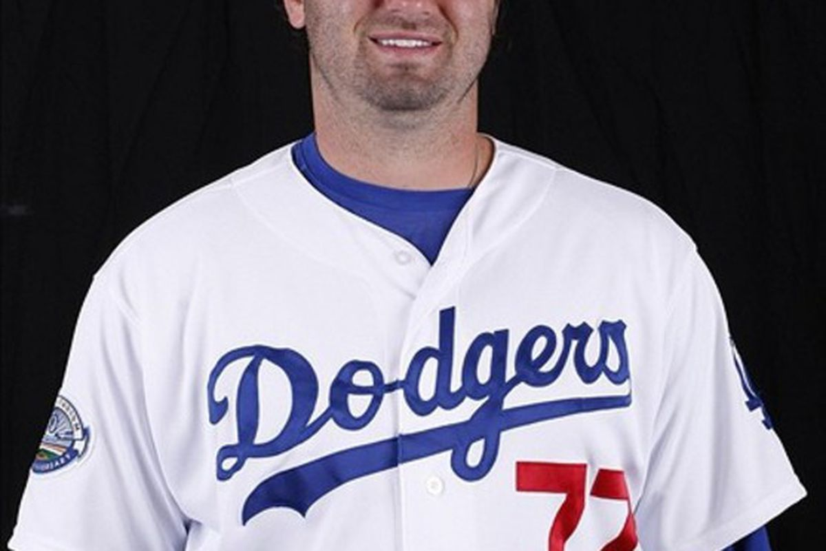 Mar 2, 2012; Glendale, AZ, USA; Los Angeles Dodgers center fielder Scott Van Slyke (77) poses for a picture during the Dodgers photo day at Camelback Ranch.  Mandatory Credit: Rick Scuteri-US PRESSWIRE