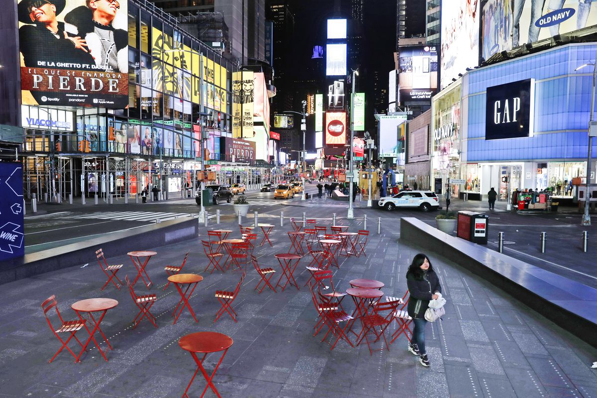 Times Square in New York City with empty tables and chairs on March 16, 2020.