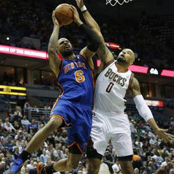 New York Knicks' Tyson Chandler(6) puts up a shot against Milwaukee Bucks' Drew Gooden during the first half of an NBA basketball game on Wednesday, April 11, 2012, in Milwaukee.