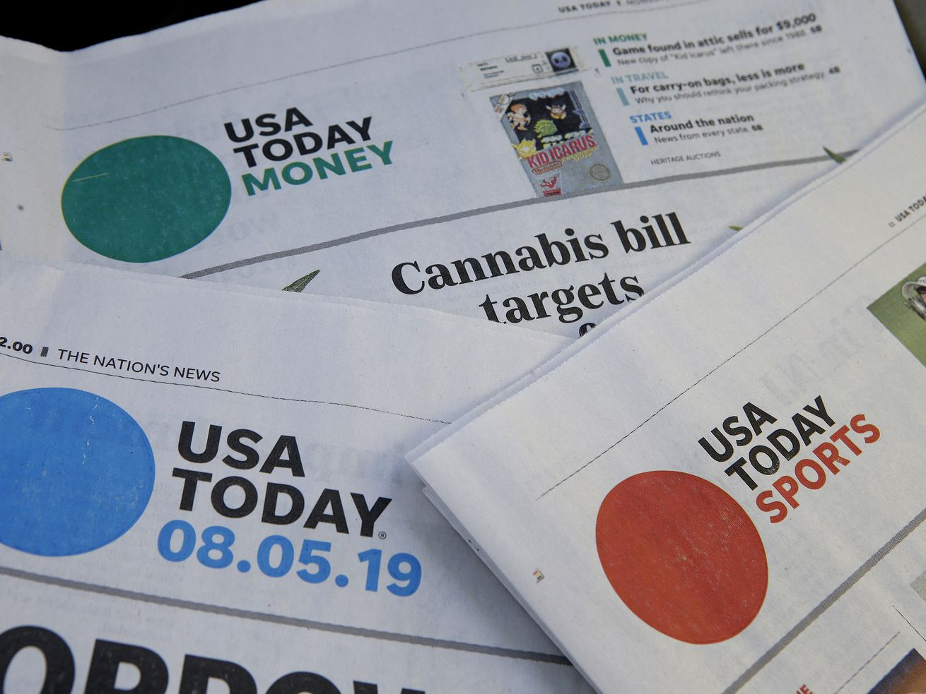In this Aug. 5, 2019, file photo, sections of a USA Today newspapers in Norwood, Mass. The FBI issued a subpoena demanding U.S. newspaper giant Gannett provide agents with information to track down readers of a USA Today story about a suspect in a child pornography case who fatally shot two FBI agents in February.