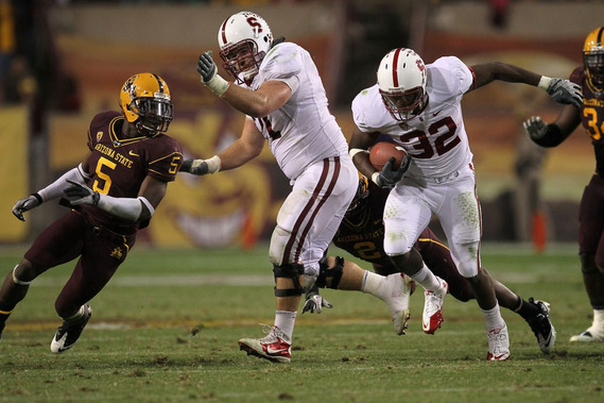 Chase Beeler clears a hole for Anthony Wilkerson against Arizona State earlier this season.