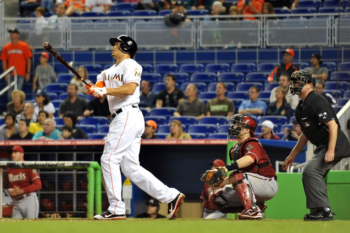 April 29, 2012; Miami, FL, USA; Miami Marlins right fielder Giancarlo Stanton (27) connects for a three run homer during the ninth inning against the Arizona Diamondbacks at Marlins Park. Mandatory Credit: Steve Mitchell-US PRESSWIRE
