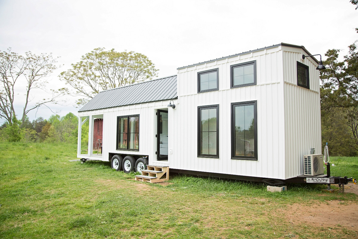 This Farmhouse Style Tiny House On Wheels Fits Family Of