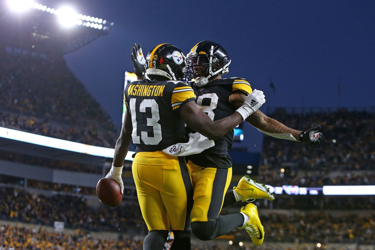 James Washington of the Pittsburgh Steelers celebrates with Jaylen Samuels after catching a 3 yard touchdown pass in the first half against the Los Angeles Rams on November 10, 2019 at Heinz Field in Pittsburgh, Pennsylvania.