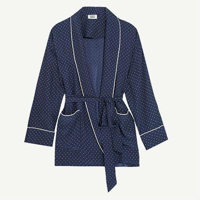 Short navy silk robe jacket with white polka dots.