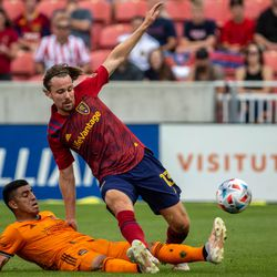 Real Salt Lake midfielder Nick Besler (13) battles the Houston Dynamo for the ball as RSL and Houston play an MLS soccer game at Rio Tinto Stadium in Sandy on Saturday, June 26, 2021.
