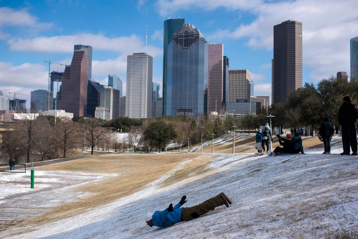 A man sleds down a snow-covered hill in Houston, Texas, on February 15.