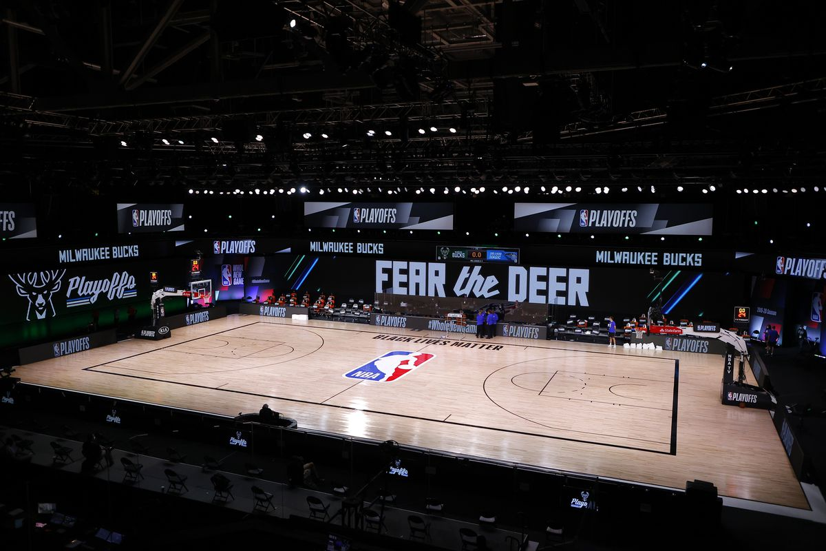 Referees huddle on an empty court at game time of a scheduled game between the Milwaukee Bucks and the Orlando Magic for Game Five of the Eastern Conference First Round during the 2020 NBA Playoffs at AdventHealth Arena at ESPN Wide World Of Sports Complex on August 26, 2020 in Lake Buena Vista, Florida.