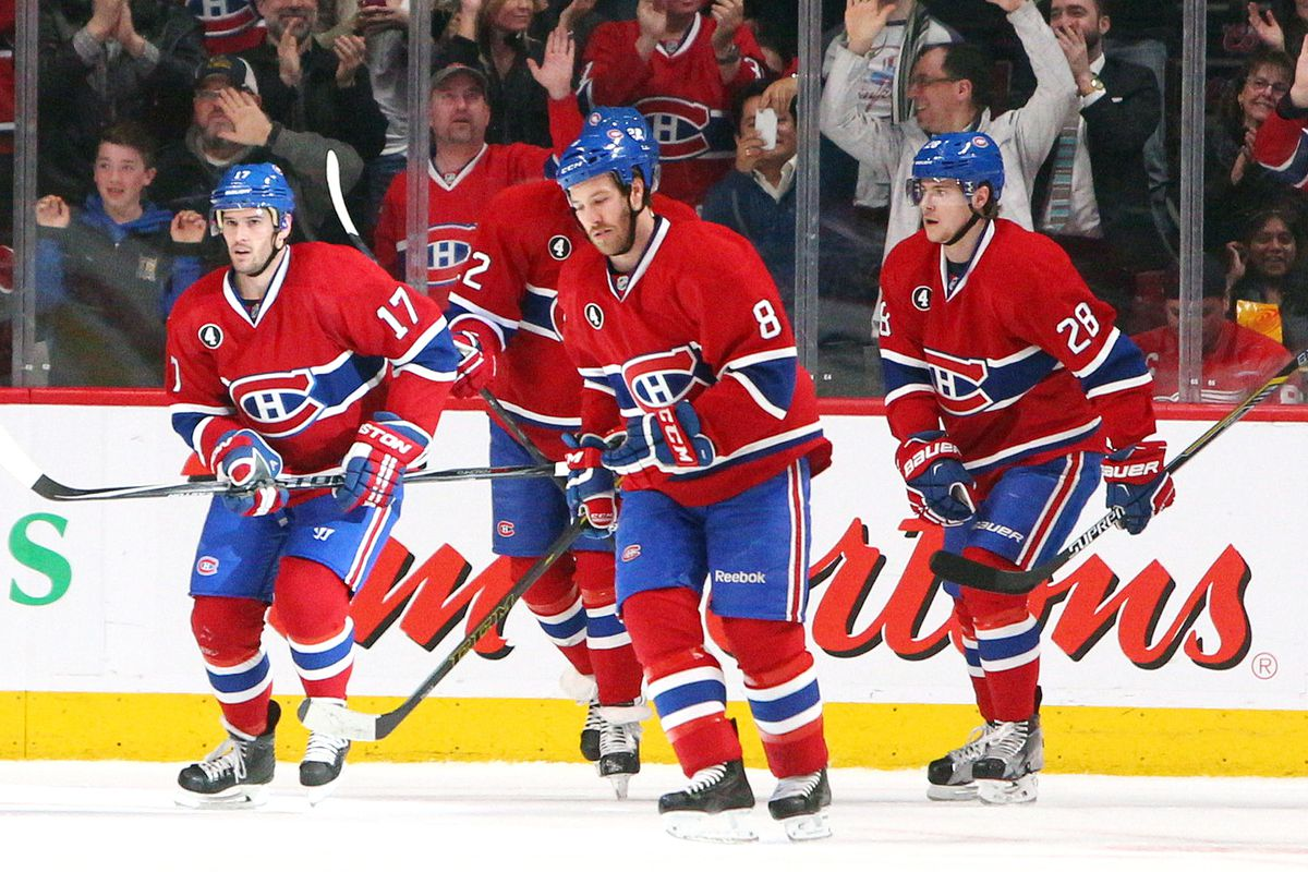 Apr 9, 2015; Montreal, Quebec, CAN; Montreal Canadiens players celebrate a Montreal Canadiens defenseman Jeff Petry (26) (not pictured) goal against the Detroit Red Wings during the second period at Bell Centre. Mandatory Credit: Jean-Yves Ahern-USA