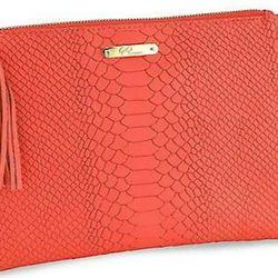 "GiGi New York All-In-One Embossed Leather Clutch, $105, <a href=""http://www.saksfifthavenue.com/main/ProductDetail.jsp?PRODUCT%3C%3Eprd_id=845524446697127&R=457194036153&P_name=GiGi+New+York&sid=14589B6AD884&Ntt=orange&N=0&bmUID=km9RqZF"">Saks Fifth Avenue"