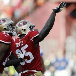 San Francisco 49ers tight end Vernon Davis, right, celebrates after scoring a touchdown on a pass reception during the first quarter of an NFL football game against the Detroit Lions in San Francisco, Sunday, Sept. 16, 2012. At left is wide receiver Michael Crabtree.