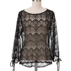 """Sheer, sexy, and super versatile. Ali black lace blouse, <a href=""""http://shop.westonwear.com/index.php/aliblk.html"""">$69</a> at Weston Wear in the Mission"""