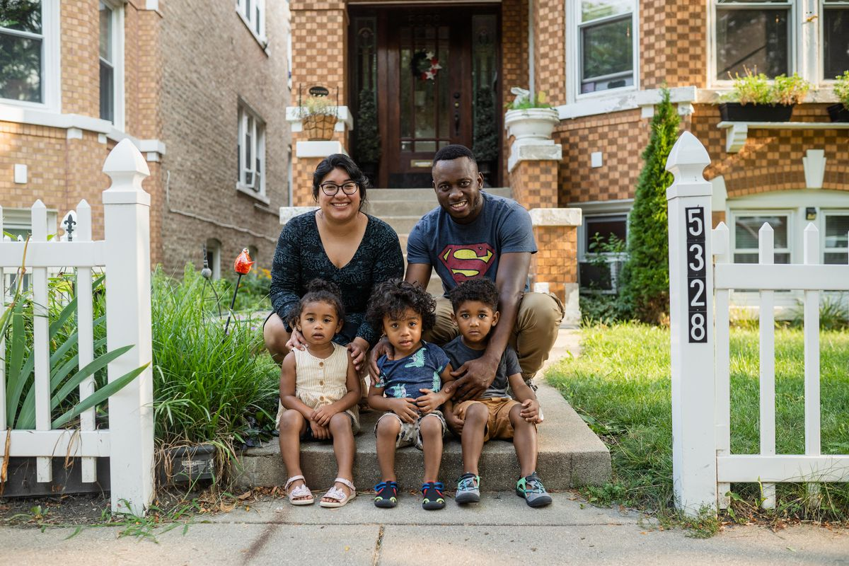 Maritza Bandera and her partner Roberto Parra pose for a picture with their kids (left to right) Arielle, Eliel and Gabriel in front of their home in the Belmont Cragin neighborhood.