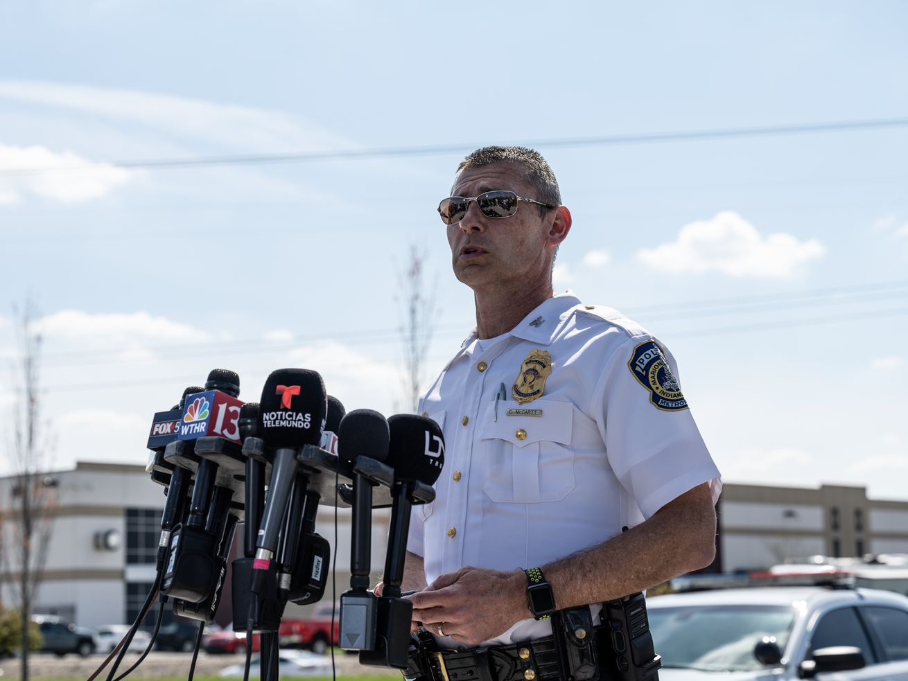 Deputy Chief Craig McCartt of the Indianapolis Metropolitan Police Department address the media with an update near the crime scene of the FedEx Ground facility on April 16, 2021 in Indianapolis, Indiana.