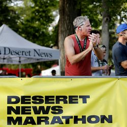People cheer at the finishing line of the Deseret News Marathon in Salt Lake City on Friday, July 23, 2021.