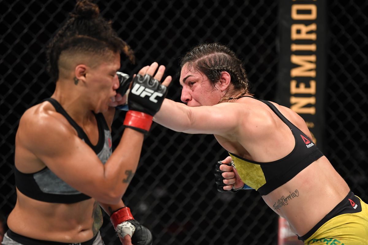 Bethe Correia of Brazil punches Sijara Eubanks in their women's bantamweight bout during the UFC Fight Night event on September 21, 2019 in Mexico City, Mexico.