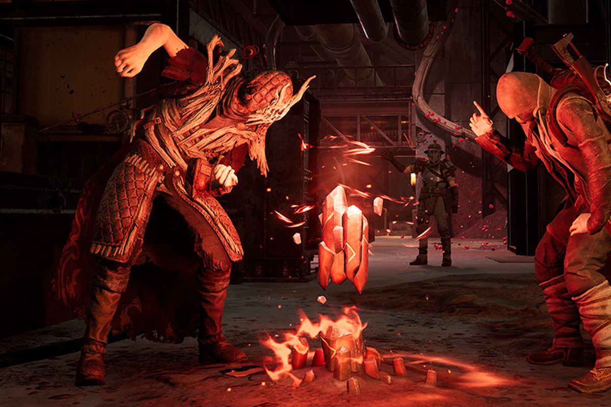 Three players in Remnant: From the Ashes stand around a fire and use emotes