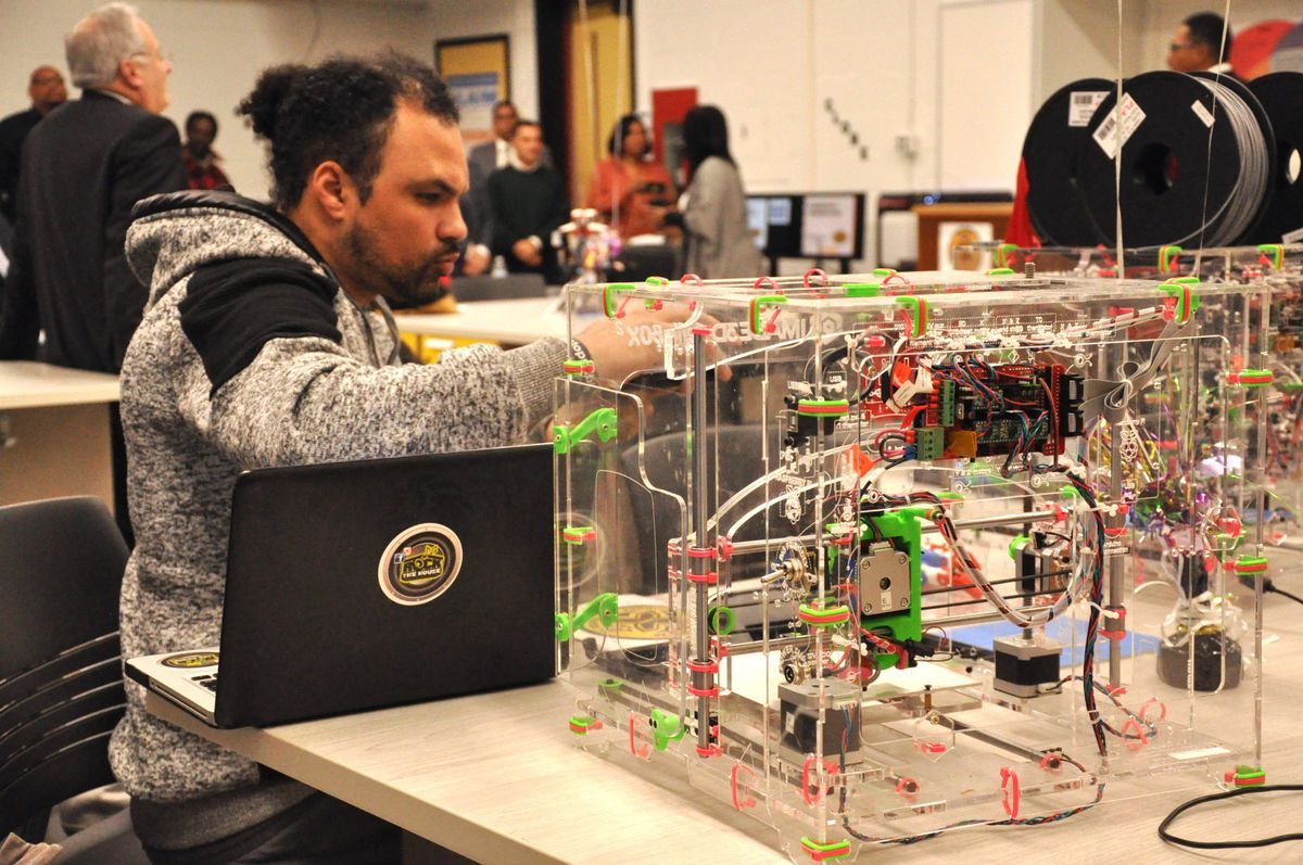 A 3-D printer is used in a lab at Malcolm X Shabazz High School.