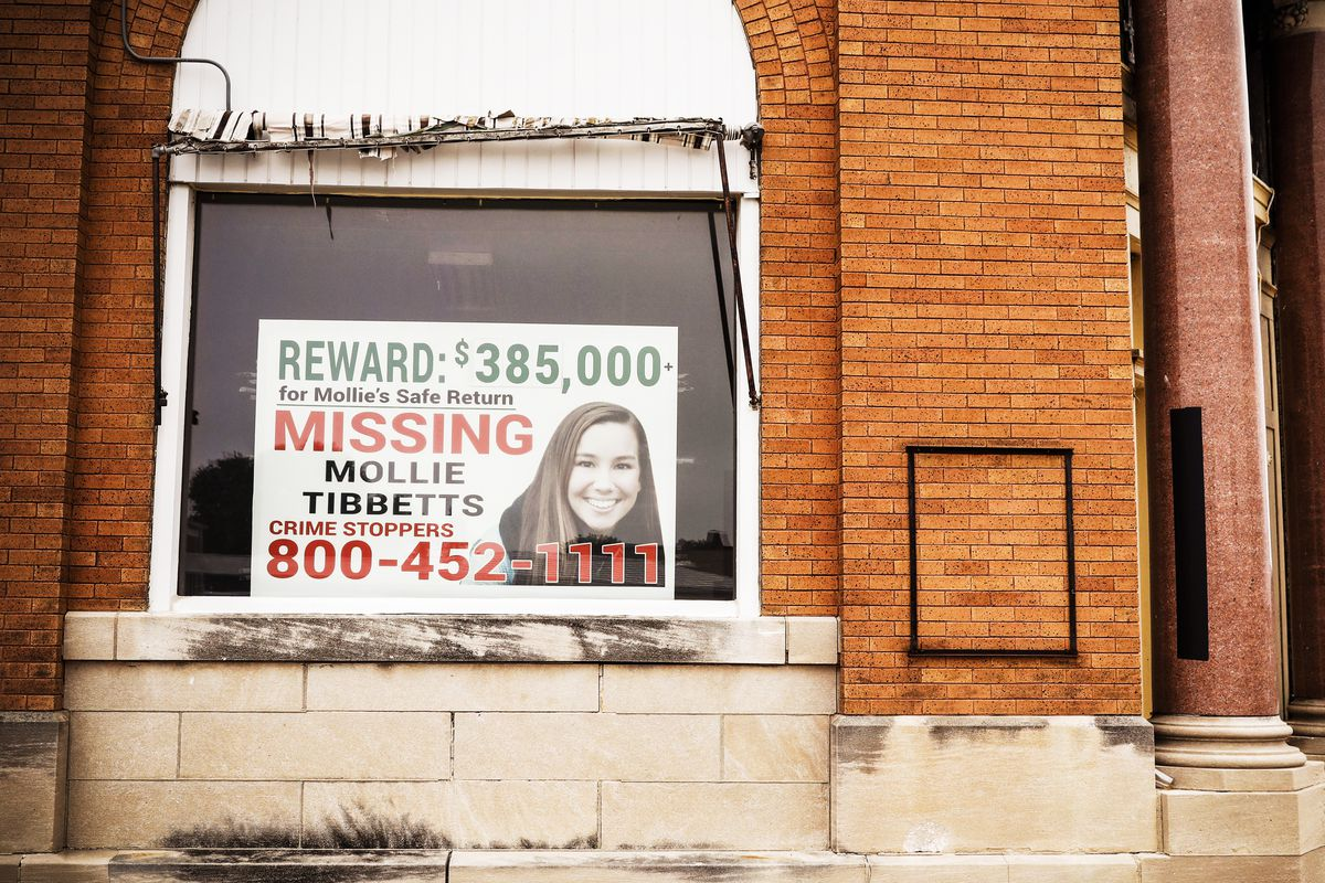 A poster for missing University of Iowa student Mollie Tibbetts hangs in the window of a local business in in Brooklyn, Iowa, on Aug. 21, 2018.