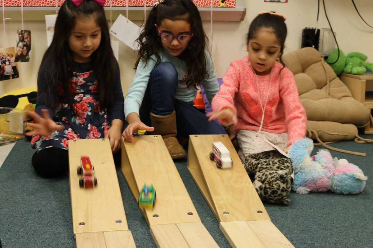 Pre-K students play during center time at The Renaissance Charter School in Jackson Heights, Queens. New York City earned high marks in a national review of pre-K programs.