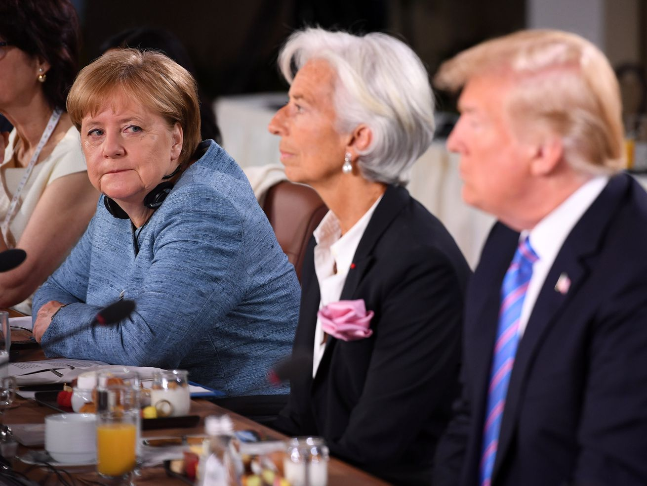 German Chancellor Angela Merkel and President Donald Trump don't agree on refugees.