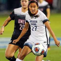 BYU Elena Medeiros (27) pushes the ball ahead of UNLV Jordan Magnin (20) as BYU and UNLV play in the first round of the NCAA tournament in Provo on Friday, Nov. 11, 2016.