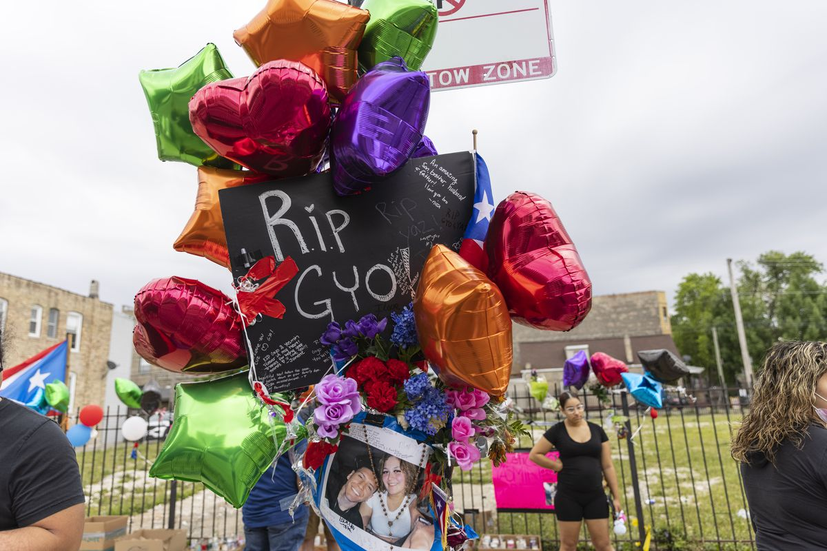 Balloons and posters are taped up on a post and fence at the memorial site for Yasmin Perez and Gyovanni Arzuaga near 3300 W. Division St in Humboldt Park, Thursday, June 24, 2021. | Anthony Vazquez/Sun-Times