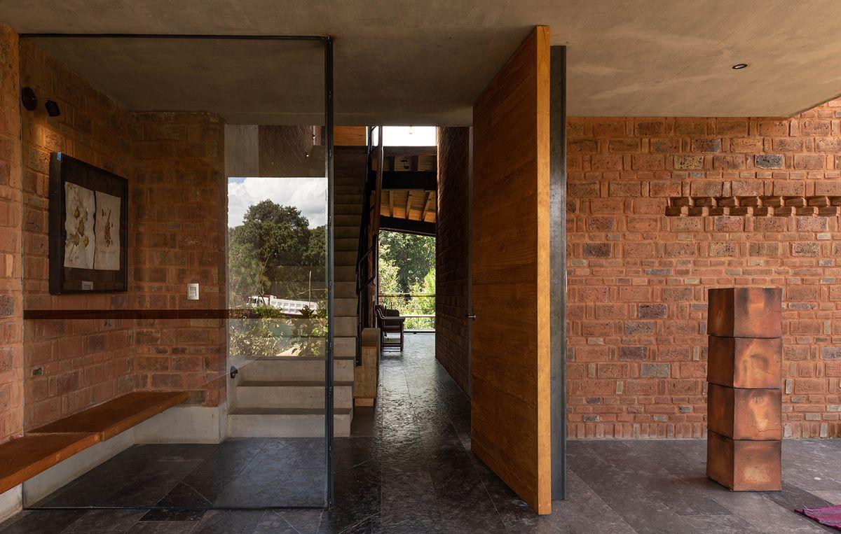 Front door opening to brick home