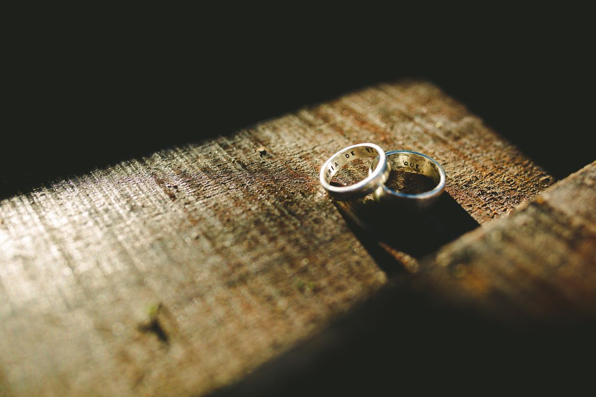 Two wedding rings photographed on a table.