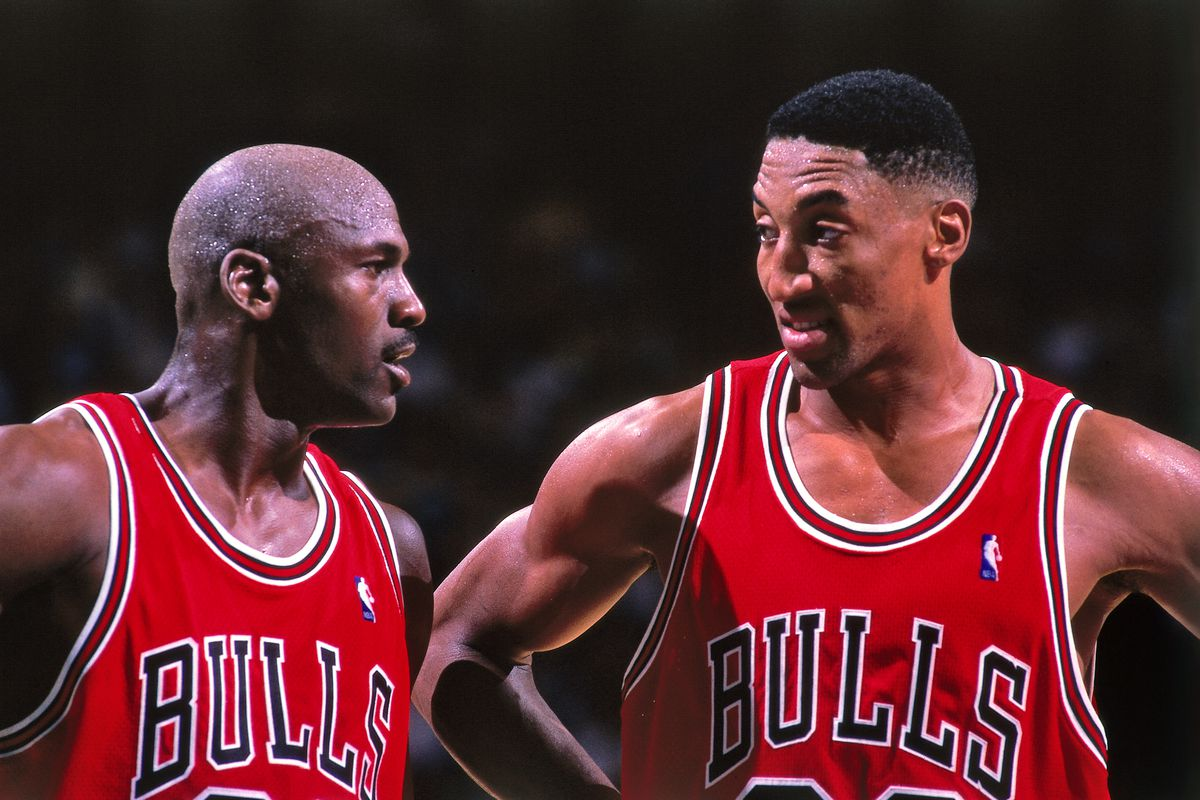 Michael Jordan and Scottie Pippen of the Chicago Bulls huddle together against the Charlotte Hornets on May 8, 1998 at Charlotte Coliseum in Charlotte, North Carolina.