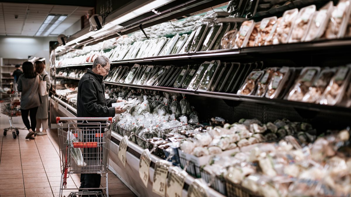 A man stands in the aisles of H-Mart in Portland