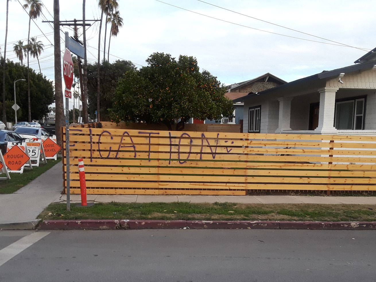 """A house in  El Sereno tagged with a message: """"fuck gentrification."""""""