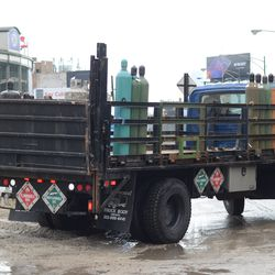 Gas cylinders being delivered in the triangle lot -