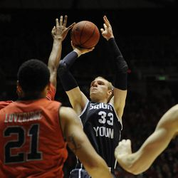 Brigham Young Cougars forward Nate Austin (33) shoots a pull up jumper during a game at the Jon M. Huntsman Center on Saturday, December 14, 2013.