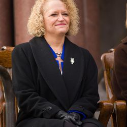 Newly installed Mayor Jackie Biskupski takes her place with members of the Salt Lake City Council during a ceremony outside the City-County Building on Monday, Jan. 4, 2016.