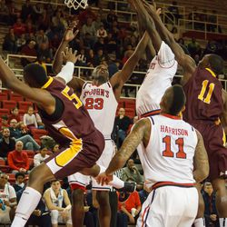 Scrum at the basket with Rysheed Jordan and D`Angelo Harrison