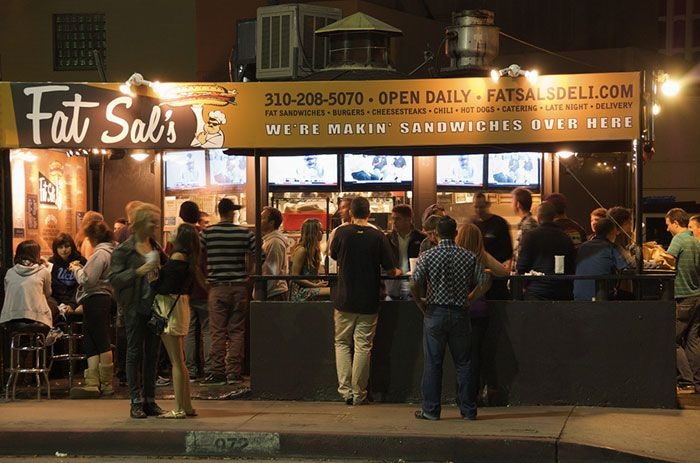 A crowd of diners gathers around Fat Sal's restaurant in the Westwood neighborhood of Los Angeles.