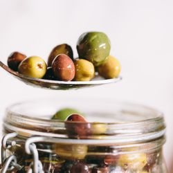 Briny balsamic mixed olives add color and acidity to the charcuterie plate.