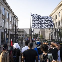 Protesters rally outside the fence guarding the Kenosha County Courthouse on the 5th night of unrest after police shot Jacob Blake, Thursday night, Aug. 27, 2020.