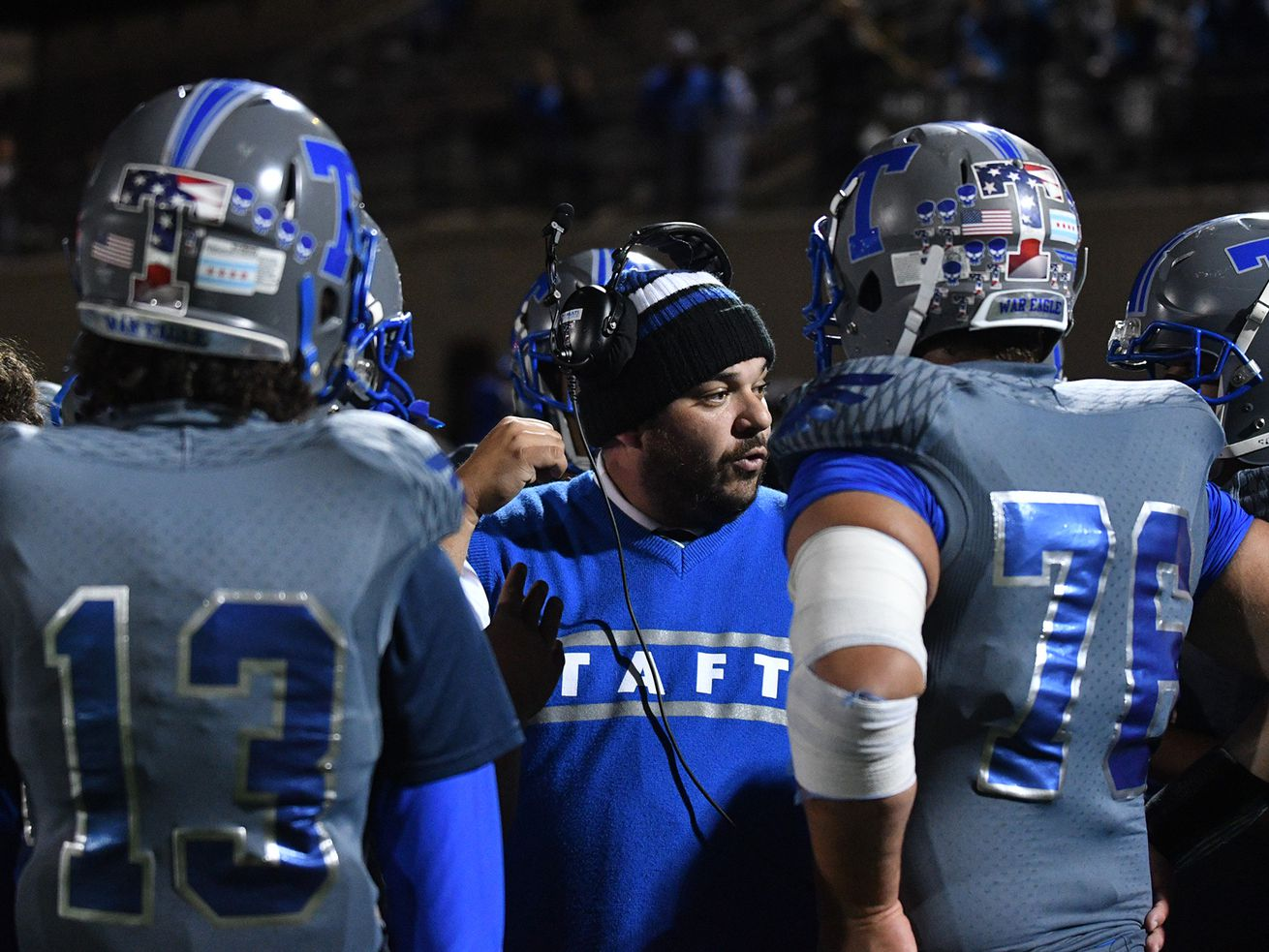 Taft coach John Tsarouchas talks to his team during a time out against Perspectives in 2018.
