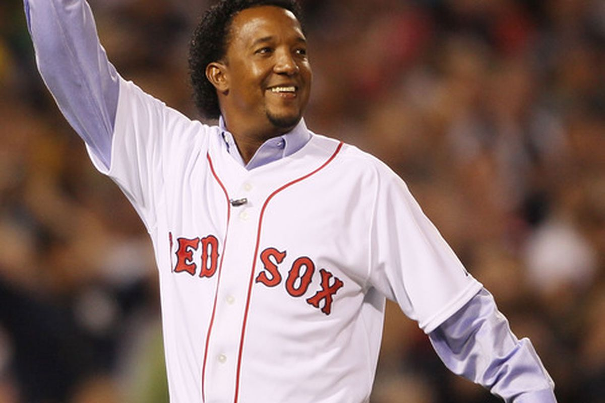 BOSTON - APRIL 04:  Former the Boston Red Sox pitcher Pedro Martinez points his finger in the air.  (Photo by Elsa/Getty Images)
