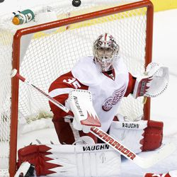 Detroit Red Wings goalie Jimmy Howard (35) blocks a shot against the Nashville Predators in the second period of Game 2 of an NHL hockey Stanley Cup first-round playoff series, Friday, April 13, 2012, in Nashville, Tenn.
