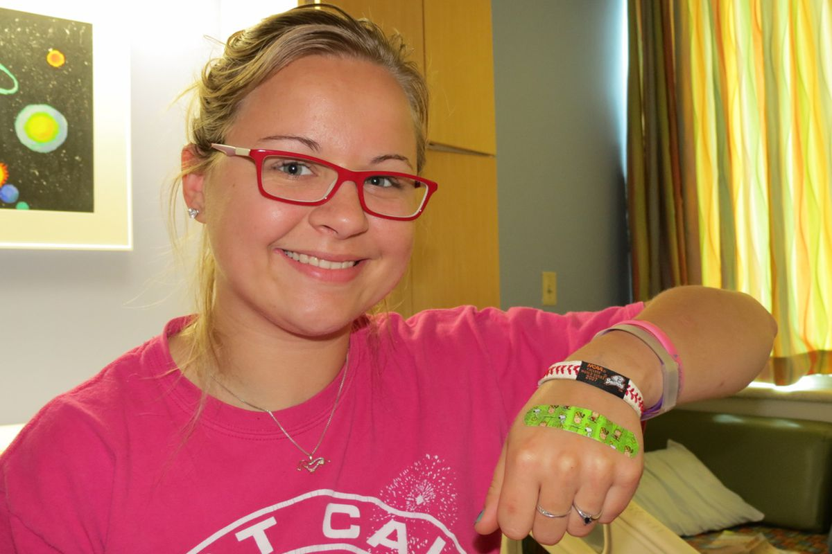 Rebecca proudly displaying the bracelet Coach Casey gave her
