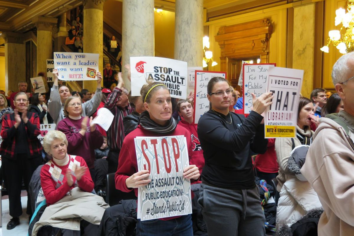 Protesters, led by teachers union, demonstrate in 2015 against changes to Indiana laws.