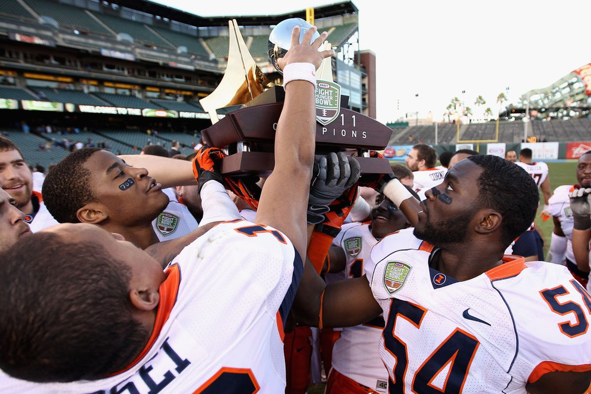 SAN FRANCISCO, CA - DECEMBER 31:  The Illinois Fighting Illini celebrate with the trophy after they beat the UCLA Bruins in the Kraft Fight Hunger Bowl at AT&T Park on December 31, 2011 in San Francisco, California.  (Photo by Ezra Shaw/Getty Images)