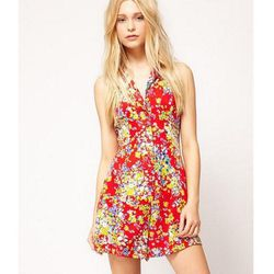 """Flirty and fun, <b>Motel's</b> <a href=""""http://us.asos.com/Motel/Motel-Ditsy-Floral-Playsuit/Prod/pgeproduct.aspx?iid=2586824&SearchQuery=playsuits&sh=0&pge=0&pgesize=204&sort=-1&clr=Red"""">Ditsy Floral Romper</a> would look just as good with flip flops and"""